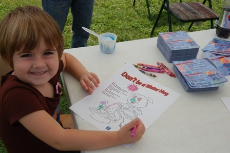 girl smiling and coloring