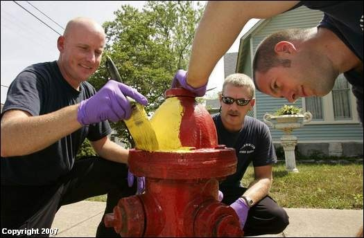 Firefighters painting a hydrant