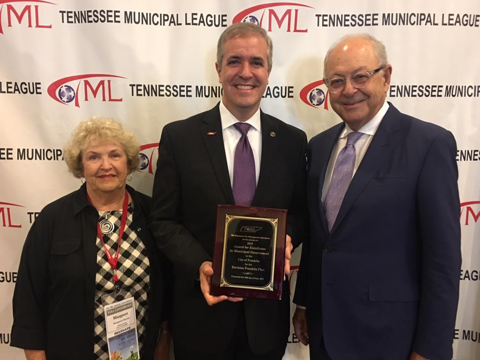 City Alderman, Mayor and Administrator accept excellence award