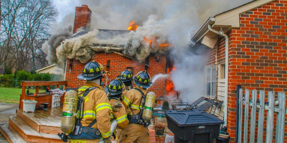 Fire Crews Battle House Fire
