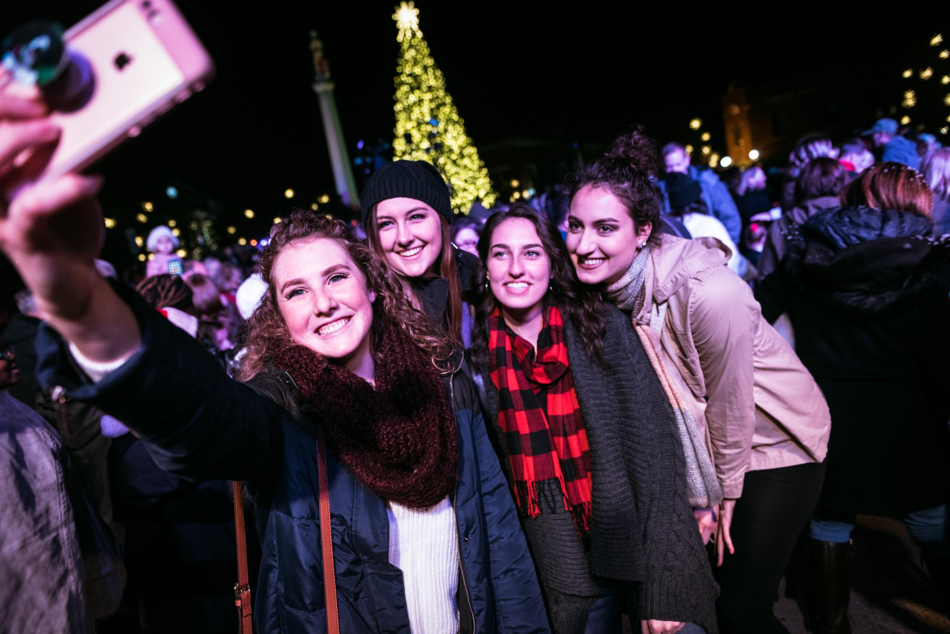 group taking selfie at tree lightin 2017