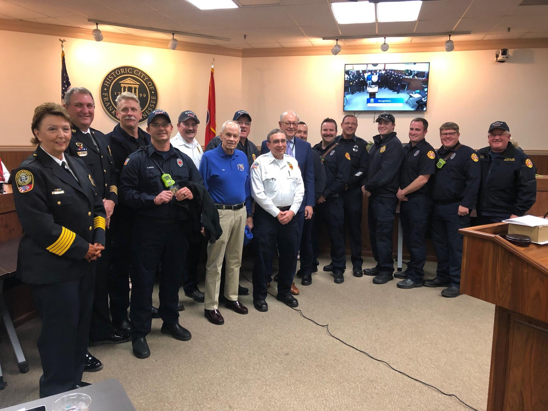 Firefighters who were honored for saving a life